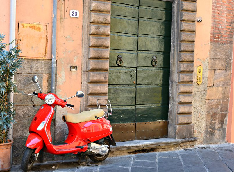 red vespa in lucca
