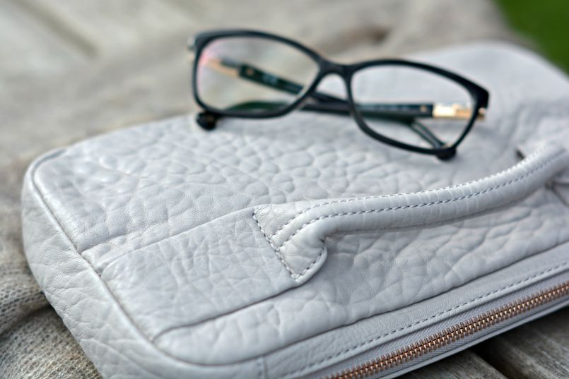 Carolina Herrera glasses | Alexander Wang pebble leather clutch