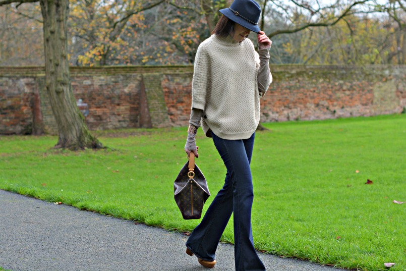 Laura Ashley poncho | Laura Ashley blue fedora | J Brand jeans flares | Louis Vuitton sully bag | Marc by Marc Jacobs tan wedge heel shoes