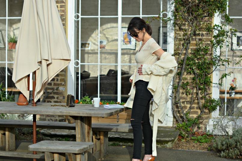 Gharani Strok cream cable knit belted cardigan | J Brand black ripped jeans | Prada tortoiseshell sunglasses | Coast cream chiffon top
