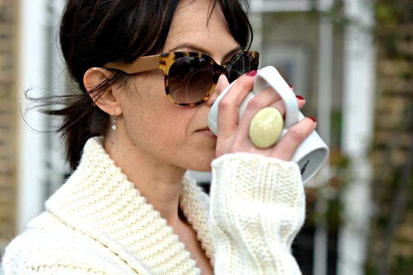 Gharani Strok cream cable knit belted cardigan   Prada tortoiseshell sunglasses   Coast cream chiffon top   Isabel Marant cream cocktail ring