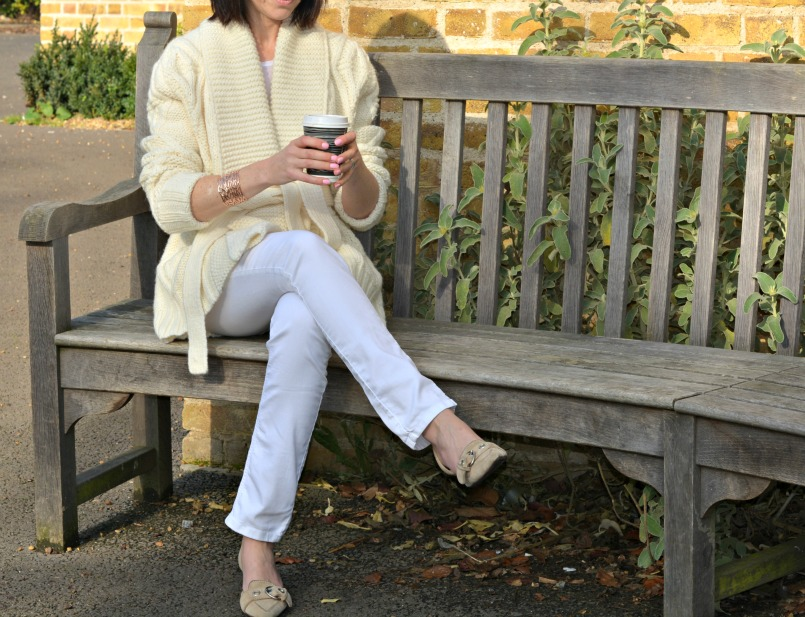 Eternal Collection Vogue Rose gold tone bangle | White Company London white skinny jeans | Prada beige pointed toe kitten heel shoes | 3.1 Phillip Lim handmade sunglasses | Gharani Strok cream cable knit belted cardigan