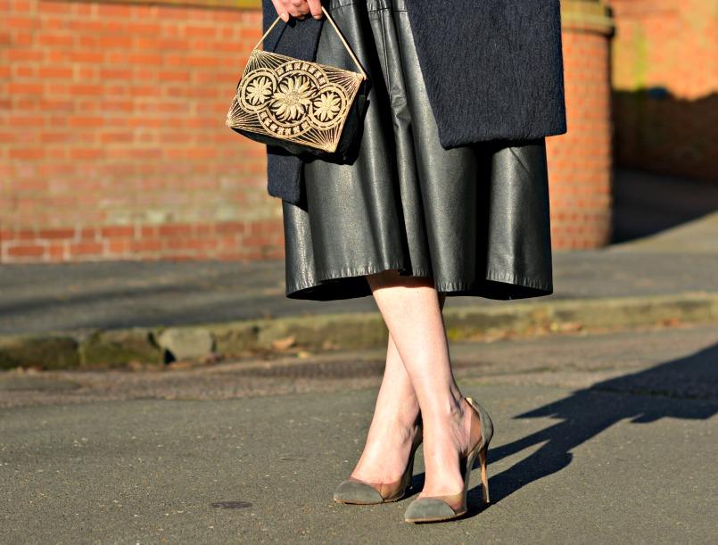 Vintage full black leather midi skirt | Maje midnight blue wool coat | 1930s Vintage beaded velvet bag | Gianvito Rossi plexi grey suede pumps