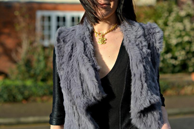 Chanel CC vintage choker | Burberry peplum top | fur gilet