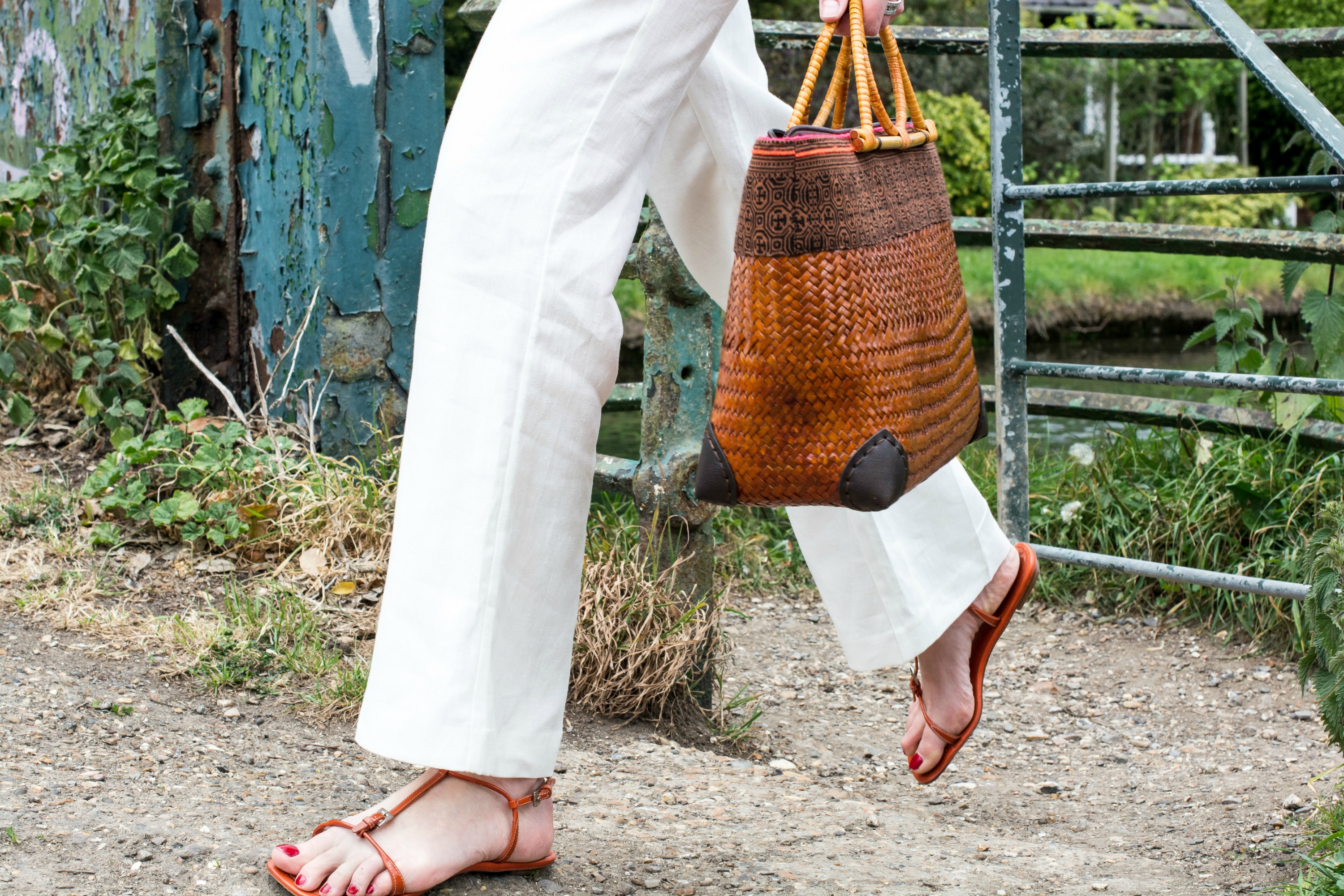 basket bag with orange sandals