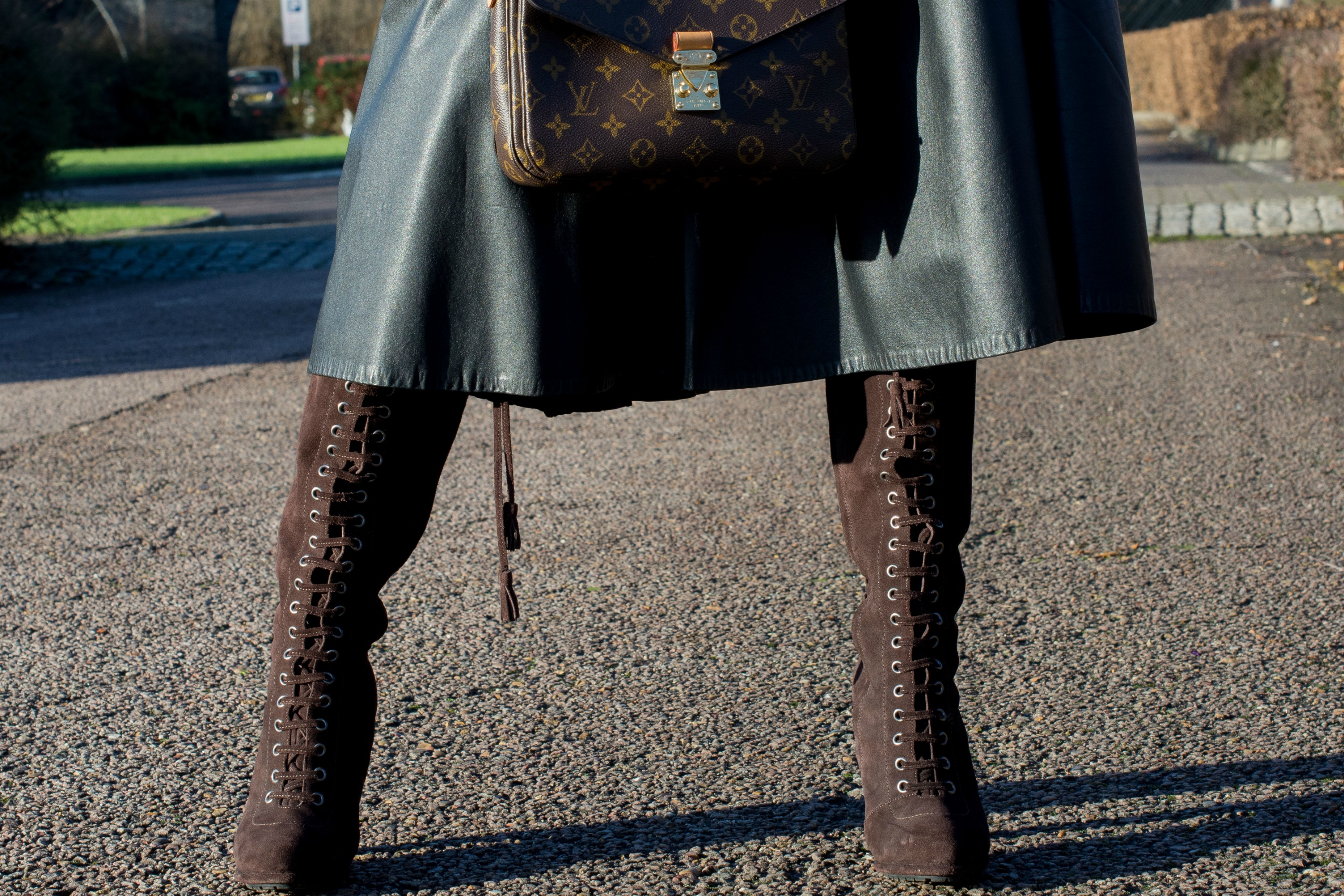 brown-suede-lace-up-boots-black-leather-full-circle-midi-skirt-louis-vuitton-metis